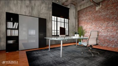 Commercial office in a modern interior with a textured feature brick wall, bookcase and cabinets and a workstation on a table facing a large feature window